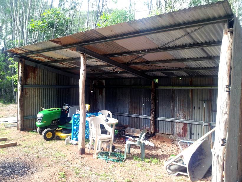 farm shed built mainly with recycled materials