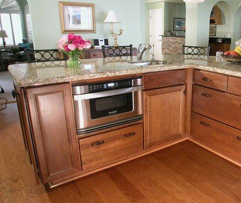 Kitchen with wood flooring